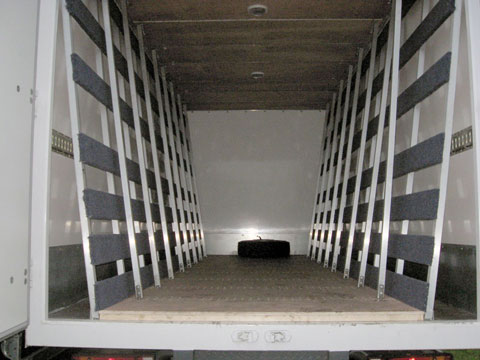Trucks fitted with Racks for Carrying Glass